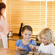 Siblings stealing cookies together — Stock Photo #11211937