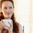 Woman with a cup in thoughts — Stock Photo #11211996