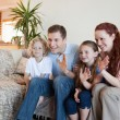 Family waving their hands — Stock Photo #11212057