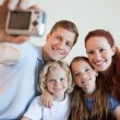 Father taking a family picture — Stock Photo