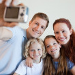Father taking family picture — Stockfoto #11212068