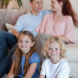 Stock Photo: Family spending time in front of tv