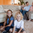 Family spending time in the living room — Stock Photo