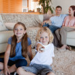 Family watching television in the living room — Stock Photo