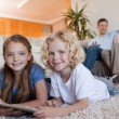 Siblings on the carpet using tablet — Stock Photo