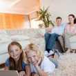 Children on the floor using laptop — Stock Photo