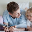 Father reading with his children - Stock Photo