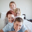 Playful family lying on each other — Stock Photo #11212263