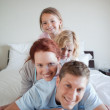 Cheerful family lying on each other — Stock Photo #11212266