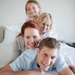 Family having fun on the bed — Stock Photo #11212269