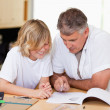 Father helping son with homework — Stock Photo #11212340