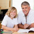Man helping his son with homework — Stock Photo