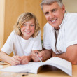 Father helping son with his homework — Stock Photo