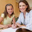 Stock Photo: Mother and daughter doing homework