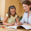 Stock Photo: Mother helping daughter with her homework