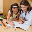 Girl getting help with homework — Stock Photo