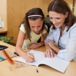 Stock Photo: Girl getting help with homework