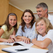 Parents helping children with homework — Stock Photo