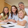 Parents helping their children with homework — Stock Photo