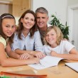 Stock Photo: Family doing homework