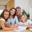 Stock Photo: Family doing homework together