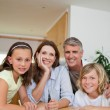 Family sitting at table — Stock Photo