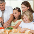 Family making sandwiches — Stock Photo