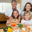Cheerful family making sandwiches — Stock Photo