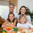 Happy family making sandwiches — Stock Photo