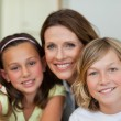 Smiling mother with children — Stock Photo