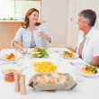 Cheerful family at the dinner table — Stock Photo