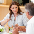 Woman talking to husband during dinner — Stock Photo