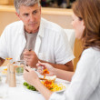 Man talking to wife during dinner — Stock Photo #11212616