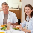 Happy couple eating dinner — Stock Photo