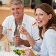 Happy couple eating dinner together — Stock Photo