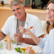 Happy couple eating their dinner — Stock Photo #11212631