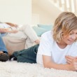 Siblings with tablet on the floor — Stock Photo