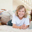 Siblings with tablet on the carpet — Stock Photo