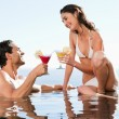 Couple having cocktails in the pool — Stock Photo