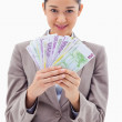 Portrait of a businesswoman holding bank notes — Stock Photo #11213414
