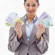 Portrait of a happy businesswoman holding bank notes — Stock Photo #11213420