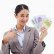 Smiling businesswoman holding bank notes — Stock Photo #11213426
