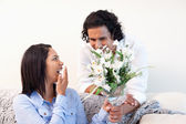 Man giving his girlfriend a bouquet — Stock Photo