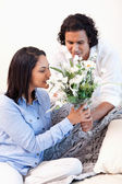 Woman getting a bouquet by her boyfriend — Stock Photo