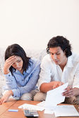 Couple talking about bad news they got by mail — Stock Photo