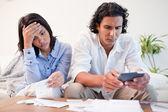 Couple checking bills — Stock Photo