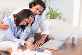 Side view of couple having a hard time paying their bills — Stock Photo