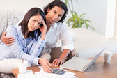 Couple having a hard time paying their bills — Stock Photo