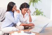 Frustrated couple underestimated their expenses — Stock Photo