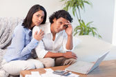 Frustrated couple underestimated their spending — Stock Photo